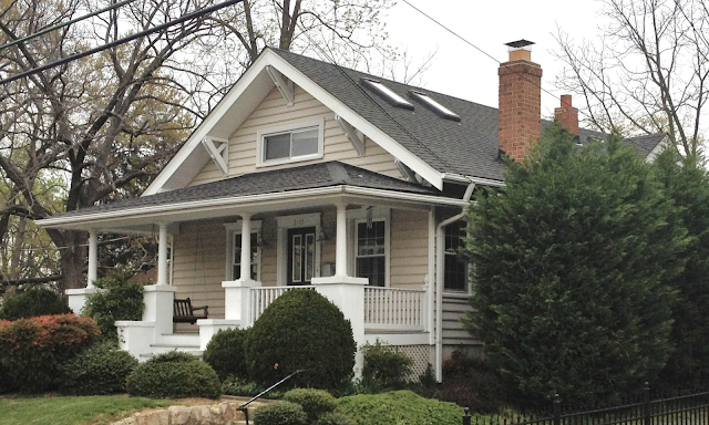 color photo of front of Sears Winona model, showing front porch and 5-piece brackets