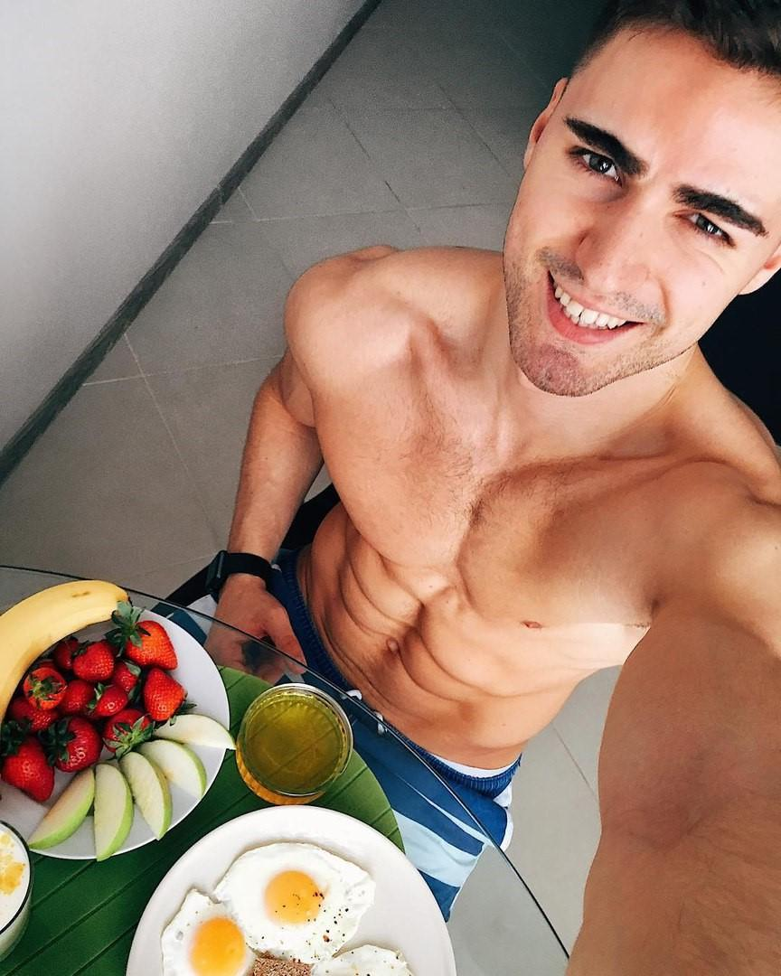 hot-bare-chest-guy-european-smiling-romanian-youngster-breakfast-eggs-fruit-soda-sixpack-abs