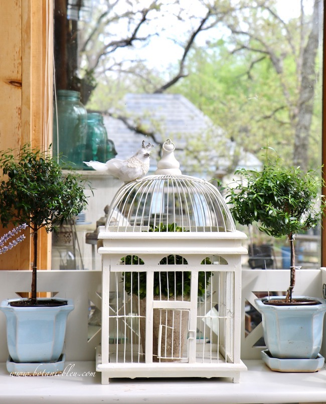 French inspired white bird cage for spring decorating in a country house sunspace