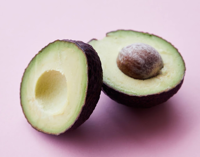 An Avocdo Sliced Open with pit