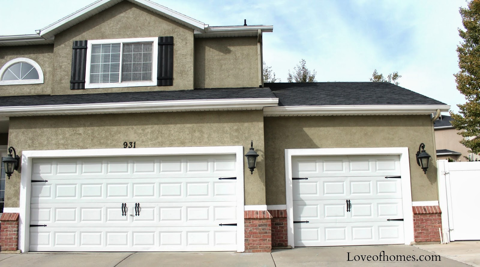 Love of homes garage doors i decided to place two sets of double handles closer together like the other door we filled the holes in with screws painted them whiteyou hardly rubansaba