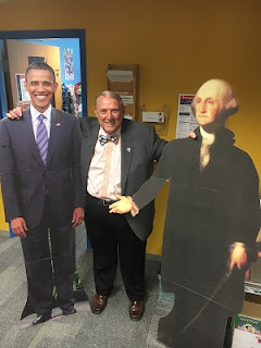 Dr. Wood with cardboard cutouts of Presidents Obama and Washington