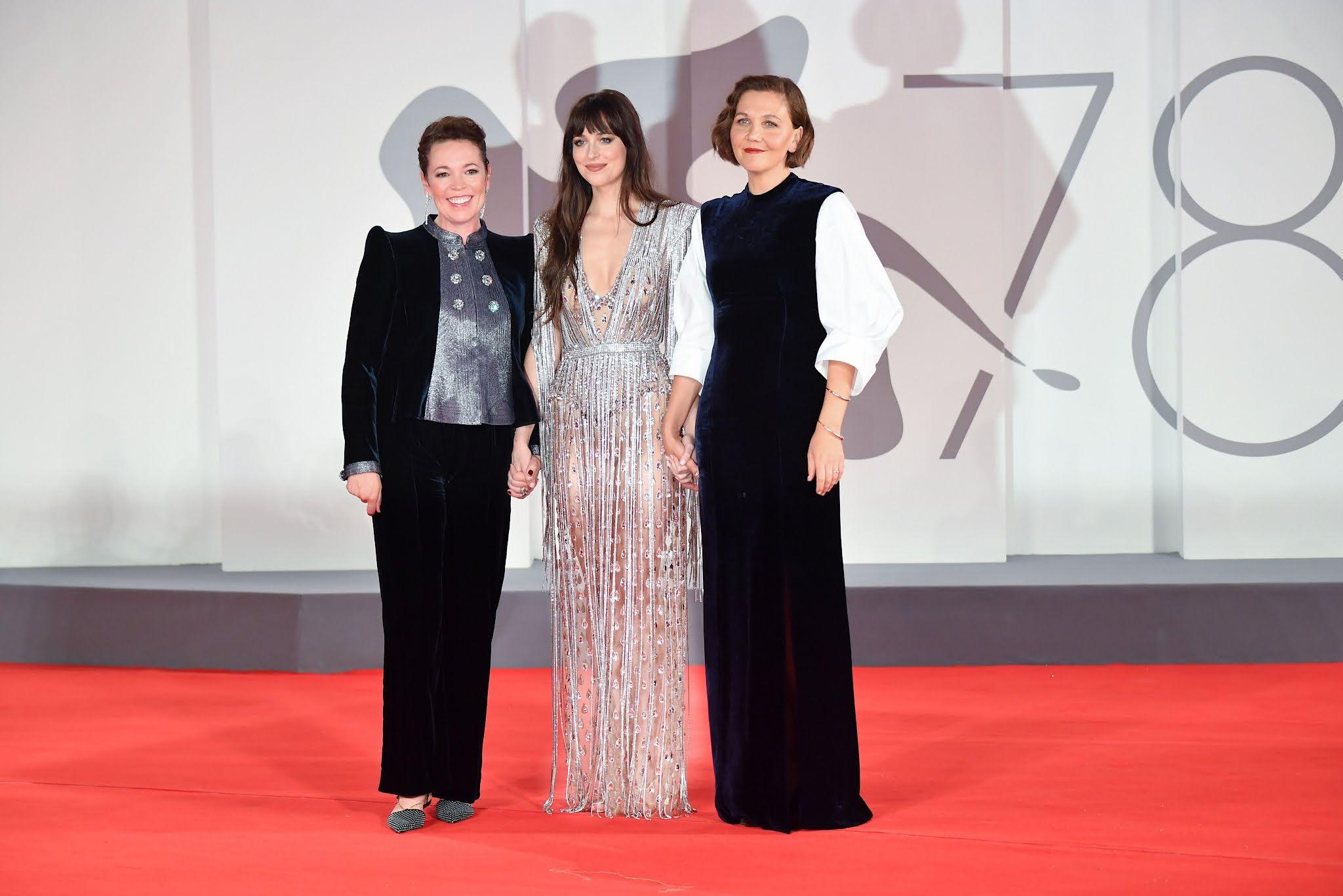 Maggie Gyllenhaal, Olivia Colman and Dakota Johnson on the Venice Film Festival red carpet for THE LOST DAUGHTER premiere