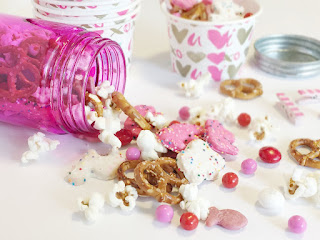Quick and easy snack made with pretzels, popcorn, animal cookies and chocolate. No Mess.