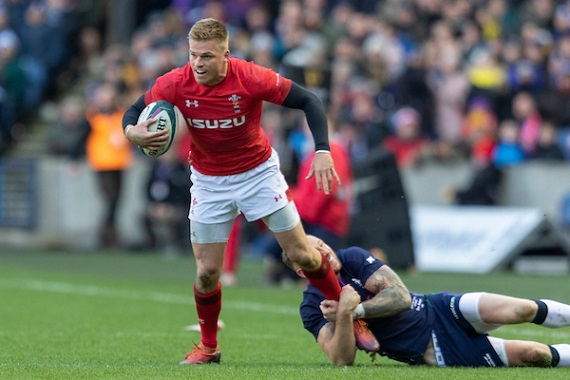 Gareth Anscombe of Wales is tackled by a Scottish defender.