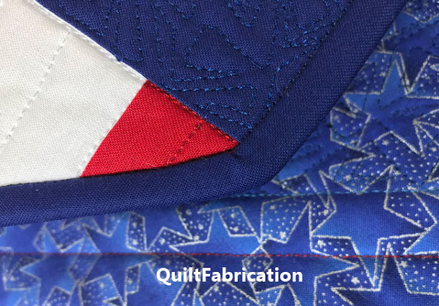 blue binding on the front of a quilt