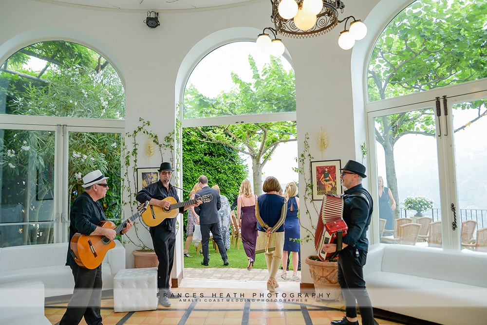 Musicians welcoming guests to wedding ceremony