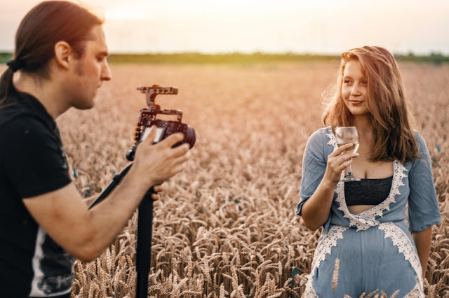A fashion photo shoot in the middle of a wheat field.