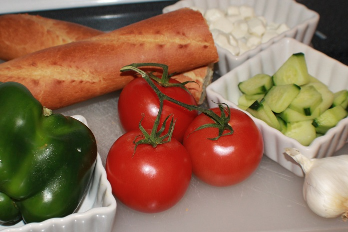 this is vine ripe tomatoes, peppers and stick Italian bread