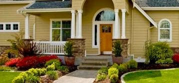 Home with beautiful fall landscaping  and curb appeal.