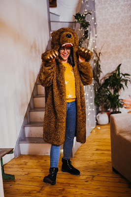 Me wearing a coat that looks like a bear with a bear head for a hood and bear claws for sleeves.