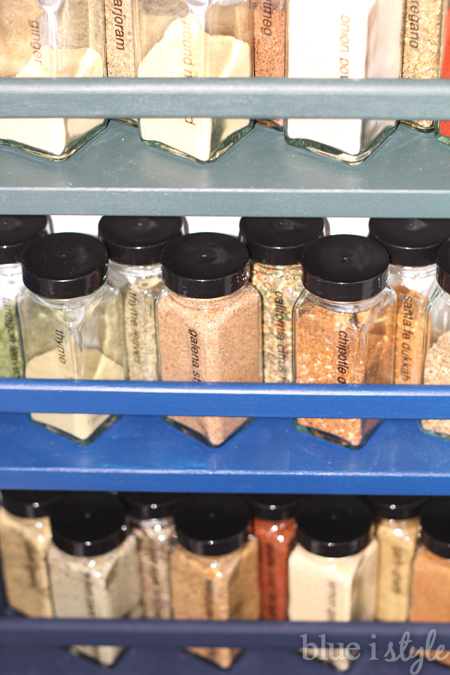 Ombre colored spice racks on pantry wall