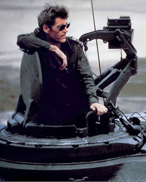 Peter O'Toole sitting on a tank in Power Play