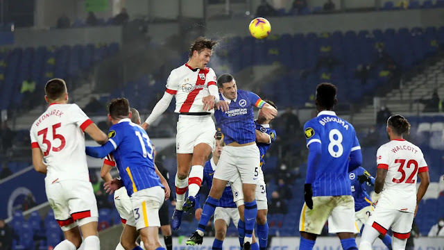Southampton and Brighton players battle for in an aerial duel