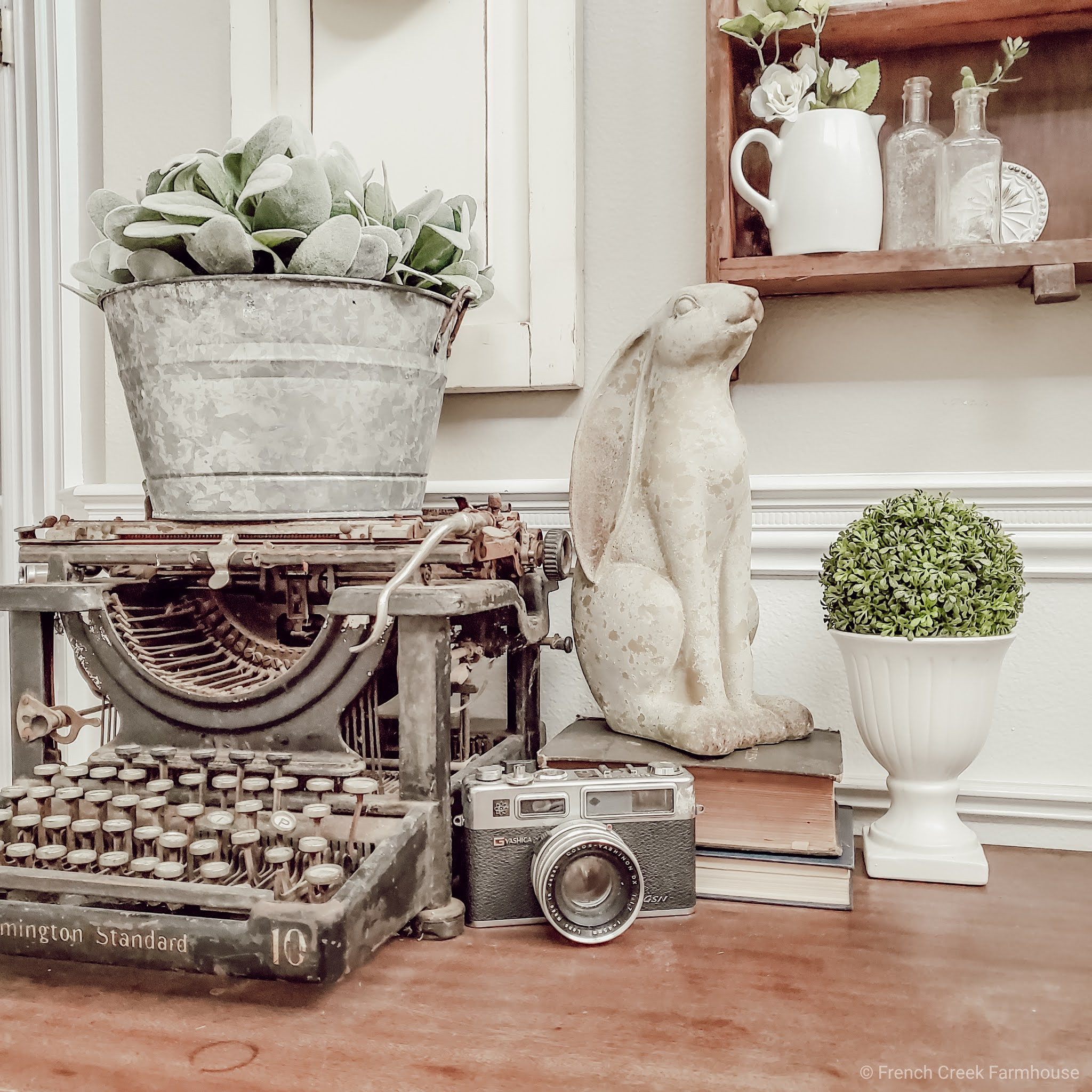 An antique typewriter is a beautiful piece of vintage decor on a console table