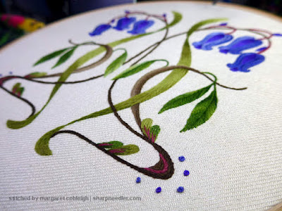 Finished off the crewel bluebells: French knots added in purple around curves at bottom