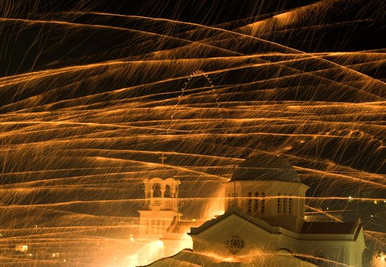 "Every Easter Saturday two rival churches in Vrondados, Greece engage in a ""rocket war"" with the aim to hit the other's belltower; they use up to 80,000 fireworks in the display."