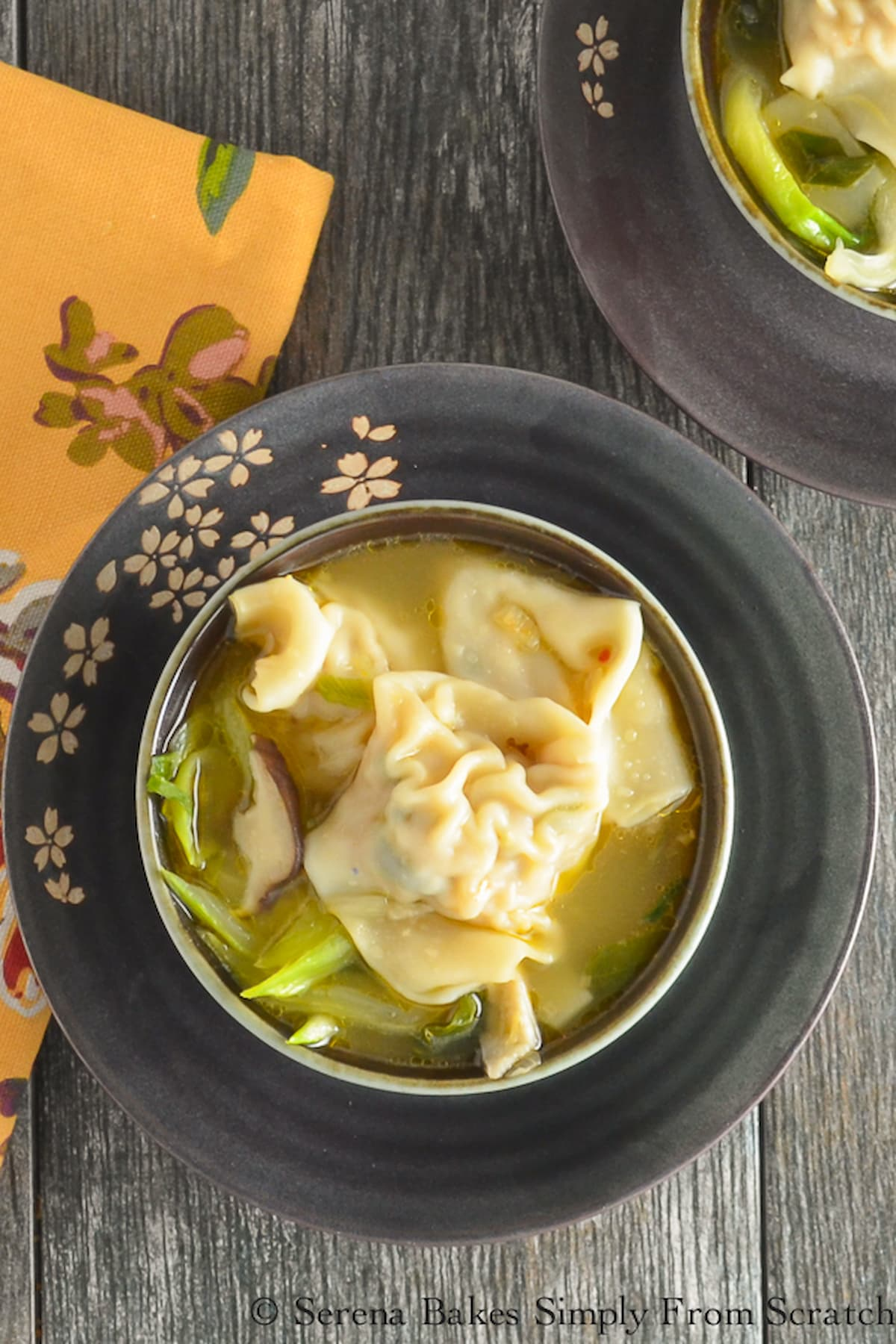 Wonton Soup in a dark grey bowl.
