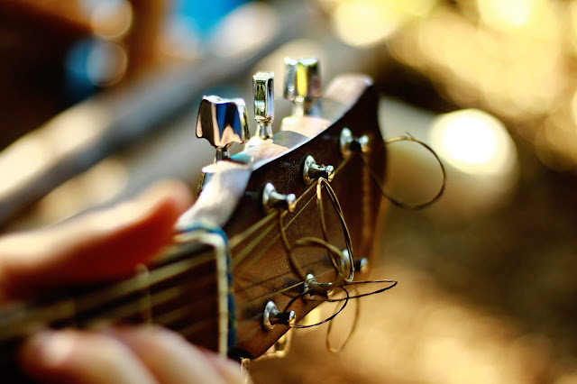 A photo of tuning a guitar