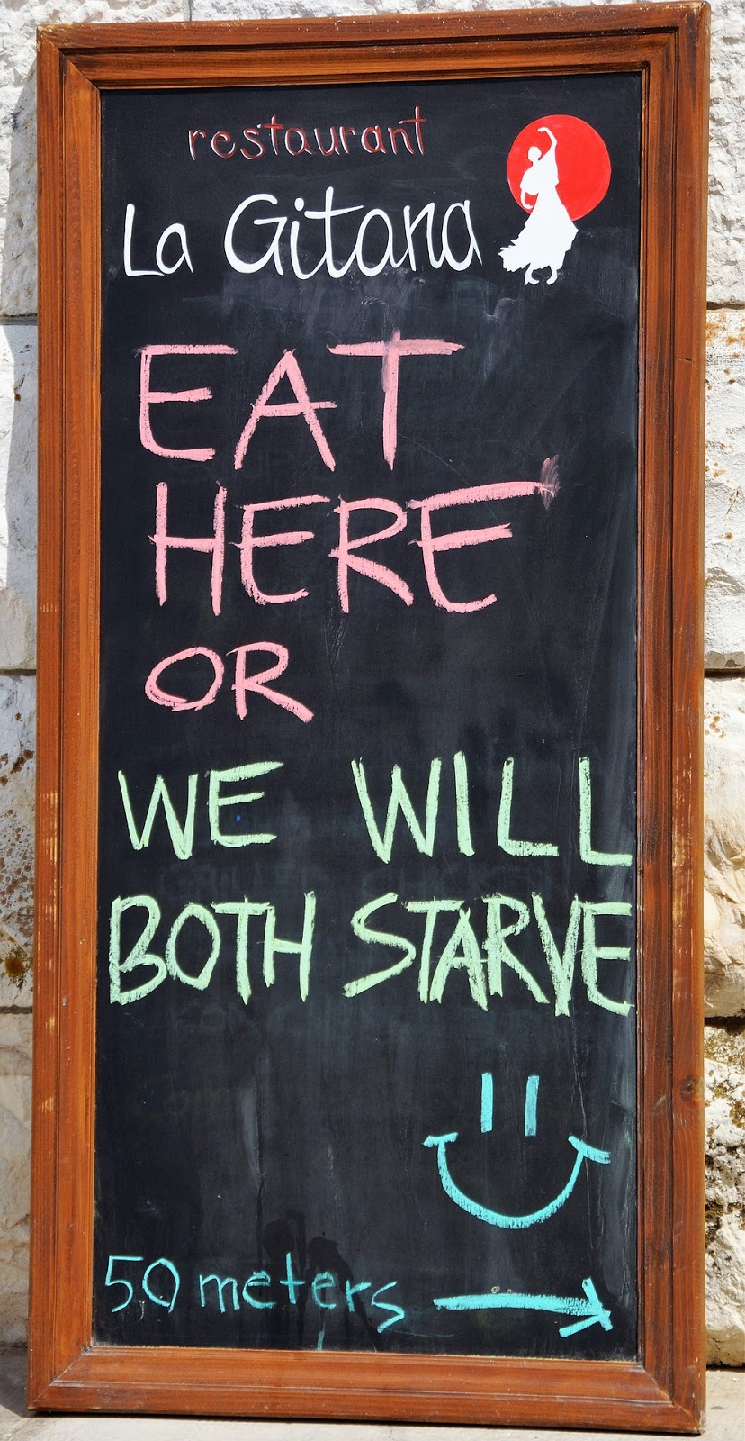 Funny restaurant advert board.