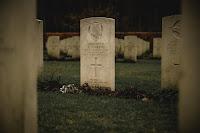 Gravestone - Photo by Alexander Andrews on Unsplash
