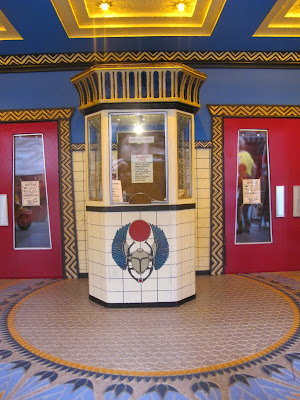 Box office in the foyer of a modern dolls' house miniature cinema.