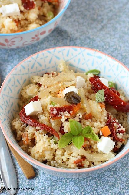 Cous Cous con pomodori secchi sott'olio, feta e melanzane sott'olio