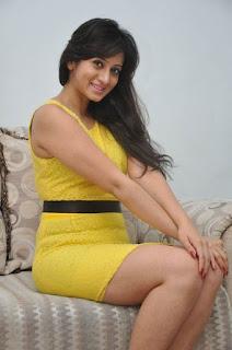 Actress Harshika Poonacha Stills in Yellow Short Dress at Appudala Ippudila Movie Promotions  0041.jpg
