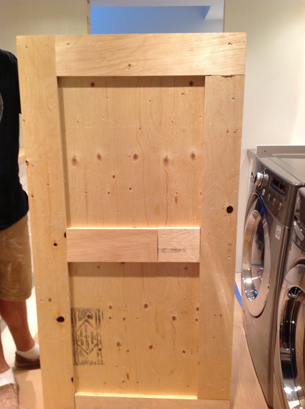 counter over front load washer and dryer, plywood countertop base, DIY floating countertop in the laundry room