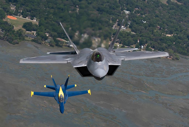 F-22 Raptor together Blue Angels