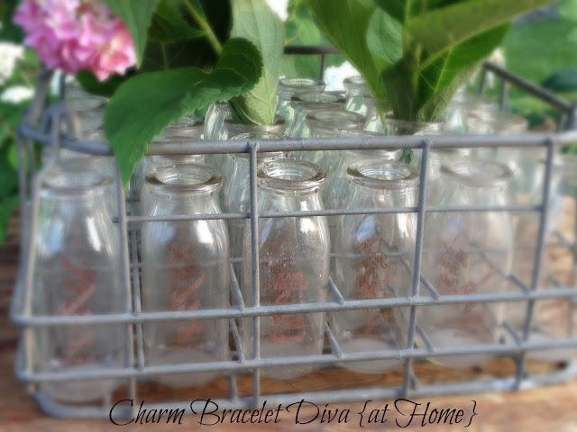 hydrangea vintage flower vase milk bottle wire carrying crate