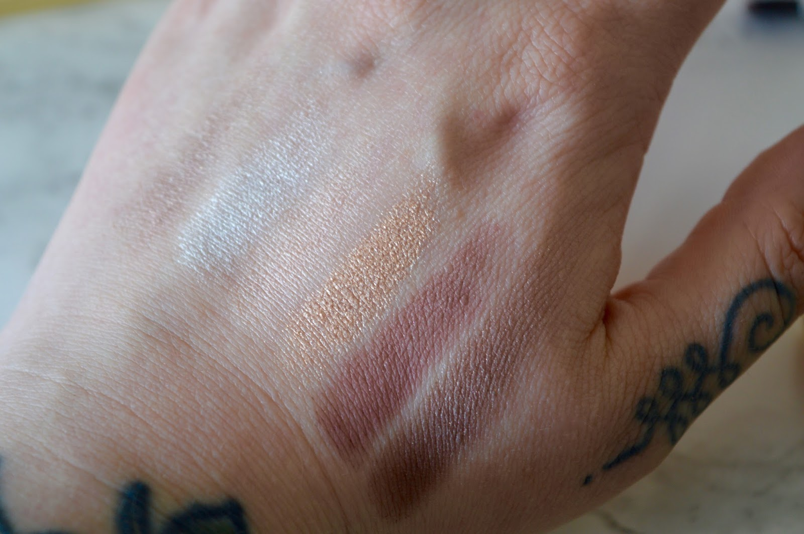 light colour swatches from the nudetude eyeshadow palette