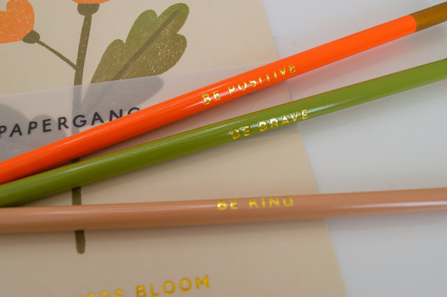 Three pencils with quotes saying be kind, be brave and be positive.