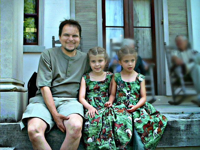 Man and twin daughters on the porch of the Belle Meade Plantation | (C) Rosevine Cottage Girls | RosevineCottageGirls.com