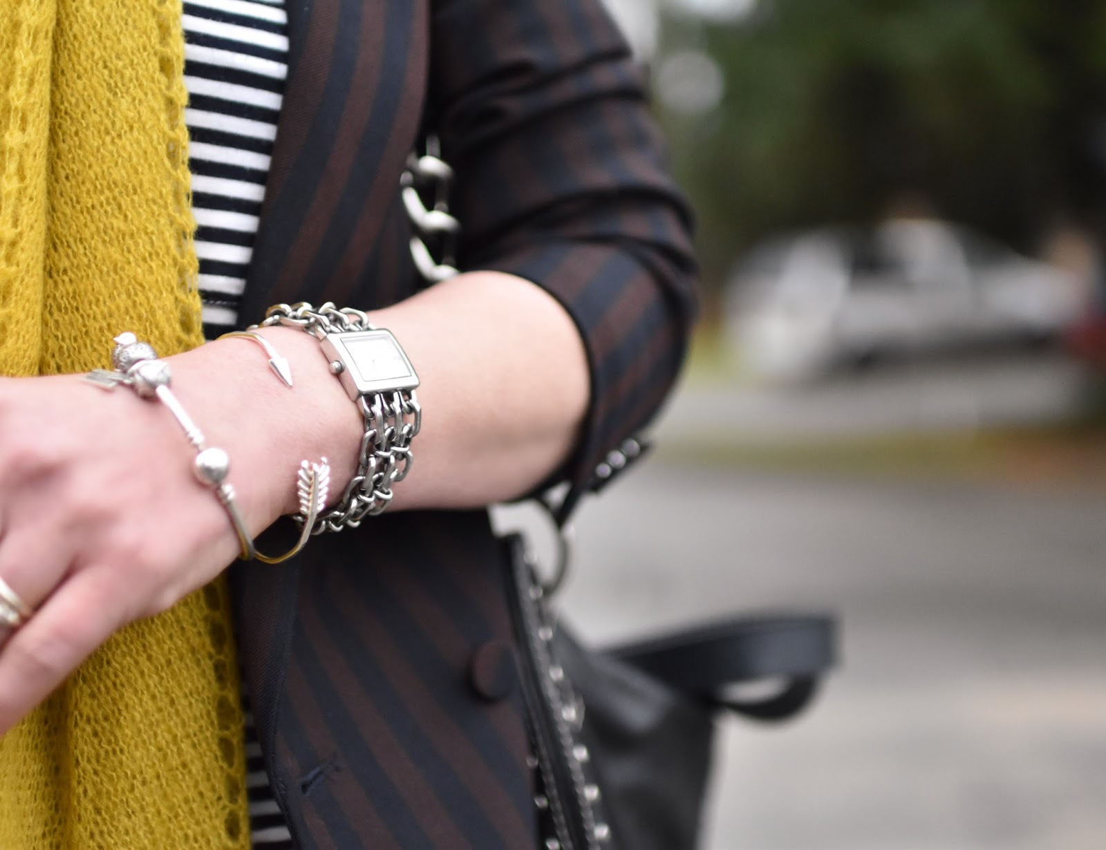 Monika Faulkner outfit inspiration - double-breasted suit jacket, striped tee, mustard scarf, stacked bracelets