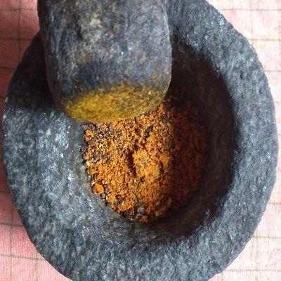ingredients of kadha crushed in mortar and pestle.