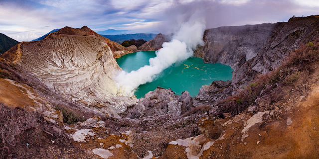 "Ijen Crater Java, Indonesia call ""Kawah Ijen"" is mountain location in Indonesia country, Banyuwangi City, East Java, has famous in the world with the phenomenon of ""blue fire"", Indonesia call name ""api biru"" which is the blue fire come out from lava contain methane gas, beside ijen volcano has uniquness ""blue fre"" ( ijen blu fire tour ) also has beauty panoramic fiew of the lake and traditional miners java work every day in ""ijen"" morning day ( kawah ijen morning tour). Nice a Holiday and Trip to ""Ijen Crater"" or  ""Kawah Ijen""east java From Bali, Surabaya, Banyuwangi, with Ijen Tamansari Tour, ijen banyuwangi, ijen volcano java, ijen java, ijen blue lava, ijen tour and service, ijen by night tour, ijen tour in morning from banyuwangi or bali."