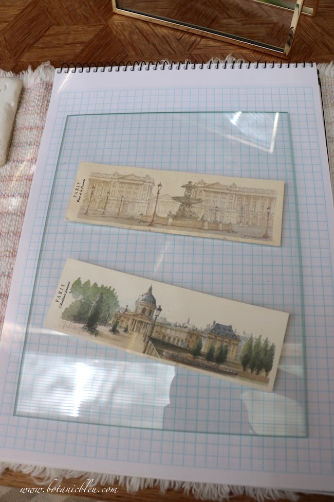 Use graph paper to determine where to place prints in a floating glass frame