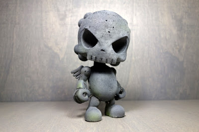 The Cement Skullhead Blank Figure by Huck Gee