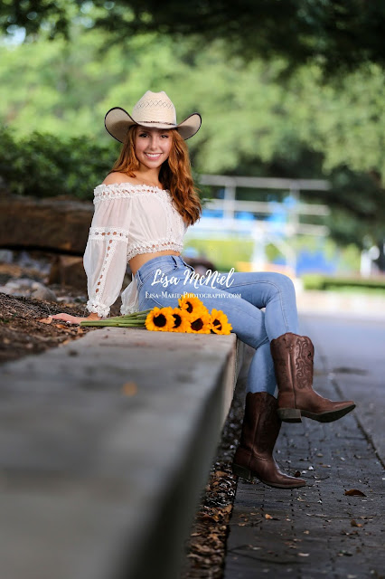 teen girl with cowboy hat and daisies