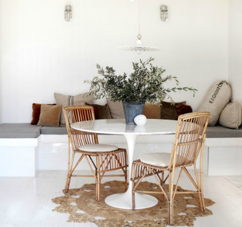 coastal cottage with a modern touch, wicker chairs and polishehite table