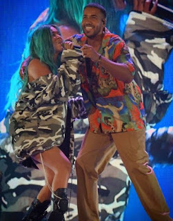 Romeo Santos performing in stage with his co-singer