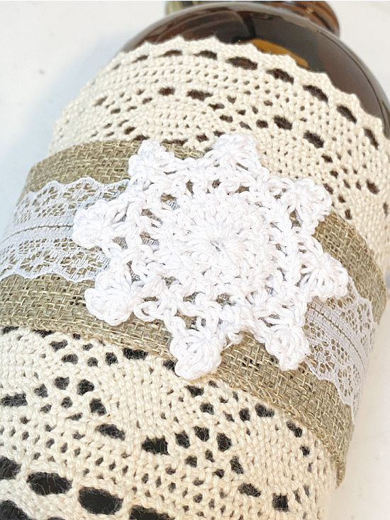 lace and doily wrapped around bottle