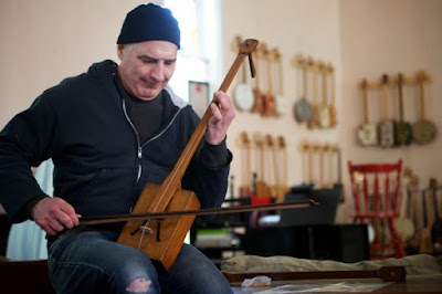http://bangordailynews.com/slideshow/saco-man-crafts-instruments-from-film-canisters-cigar-boxes-yardsticks-and-more/