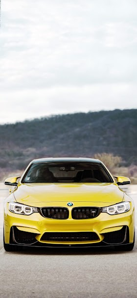 Yellow BMW sport car on road wallpaper