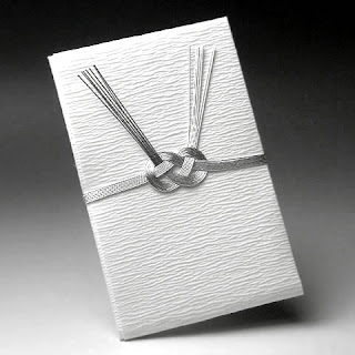 A specially-wrapped envelope used for giving a gift of money at a funeral.