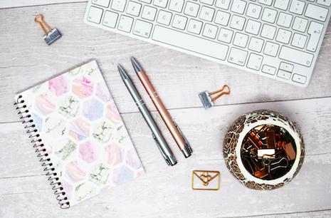 February 2020 - notepad, pens and keyboard flat lay