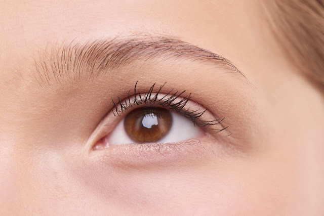 Woman Learning How To Make Your Eyelashes Grow Overnight