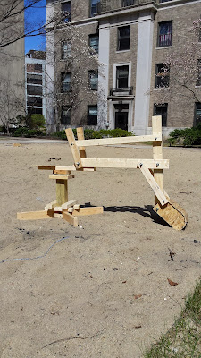 wooden backhoe toy in sand area