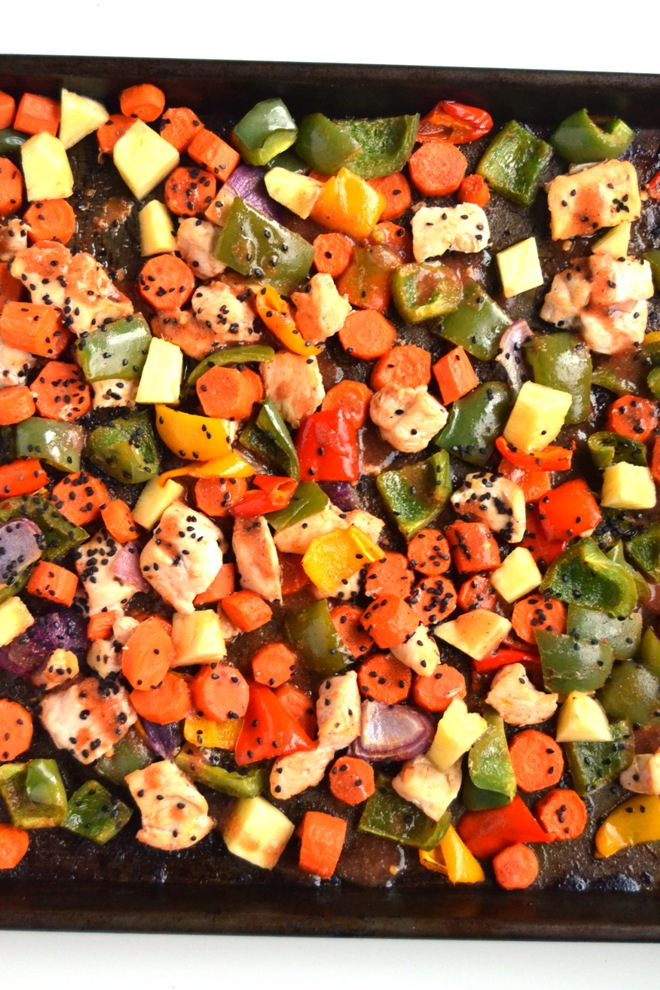 Sheet Pan Sweet and Sour Chicken is an easy dinner cooked all on one tray for fewer dishes to wash and less work! Features pineapple, bell peppers, carrots, chicken and a homemade sweet and sour sauce. www.nutritionistreviews.com